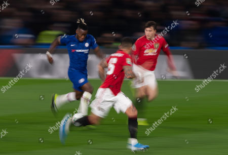 Michy Batshuayi of Chelsea runs at Marcos Rojo of Manchester United