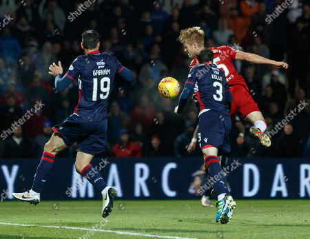 Filip Helander of Rangers heads the ball under pressure from Brian Graham & Sean Kelly of Ross County