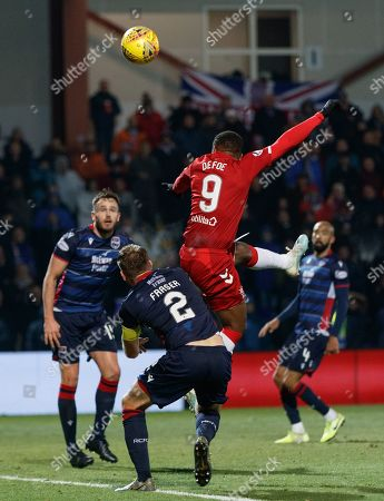 Stock Picture of Jermain Defoe of Rangers heads above Marcus Fraser of Ross County.
