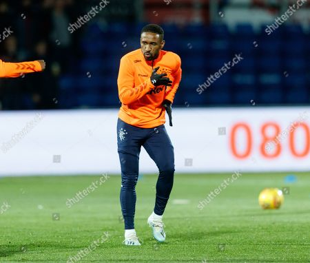 Jermain Defoe of Rangers warms up on a cold night in Dingwall.