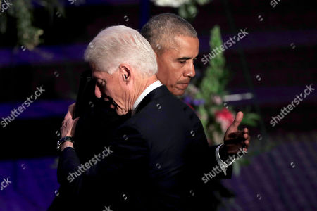 Former presidents Barack Obama, left, and Bill Clinton hug at the end of funeral services for Rep. Elijah Cummings, in Baltimore. The Maryland congressman and civil rights champion died Thursday, Oct. 17, at age 68 of complications from long-standing health issues