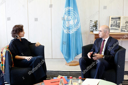 Swiss Confederation President Alain Berset, right, and UNESCO'S Director-General Audrey Azoulay talk before a meeting on protection of underwater cultural héritage, at the UNESCO's headquarters in Paris