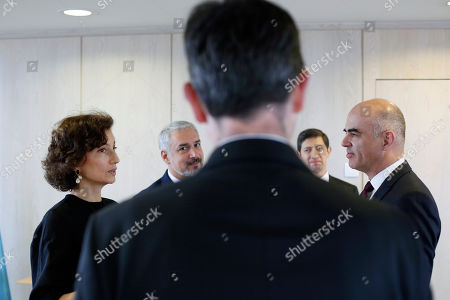 Swiss Confederation President Alain Berset, right, and UNESCO'S Director-General Audrey Azoulay, left, talk before a meeting on protection of underwater cultural héritage, at the UNESCO's headquarters in Paris