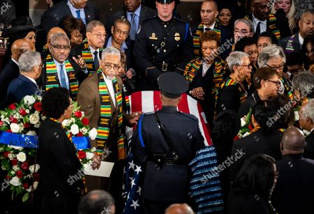 United States Representative Bobby Rush (Democrat of Illinois), left, leads the Congressional Black Caucus in a prayer at US Representative Elijah Cummings (Democrat of Maryland) casket as he lies in state within Statuary Hall during a memorial ceremony on Capitol Hill in Washington, DC.