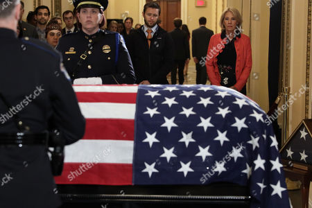 """United States Secretary of Education Betsy DeVos, right, pays respects to US Representative Elijah Cummings (Democrat of Maryland) as the late congressman lies in state outside the US House chamber at the U.S. Capitol in Washington, DC. Rep. Cummings passed away on October 17, 2019 at the age of 68 from """"complications concerning longstanding health challenges."""""""