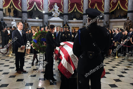 United States Representative Adam Schiff (Democrat of California) waits in line as US Representative Alexandria Ocasio-Cortez (Democrat of New York) pays her respects to United States Representative Elijah Cummings (Democrat of Maryland) in National Statuary Hall at the United States Capitol in Washington, DC. The service preceded Cummings lying in state in front of the US House chamber.