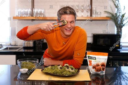 David Burtka goofs around with his spooky ghoul eyeballs, made with Gardein's meatless meatballs, in New York