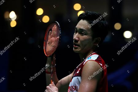 Kento Momota of Japan reacts after losing his Men's singles quarter final match against Anthony Sinisuka Ginting of Indonesia at the Yonex Badminton French Open tournament in Paris, France, 25 October 2019.