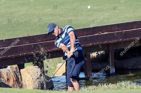 South Africa's Trevor Immelman hits from a bank slope during the third day of the Portugal Masters golf tournament, in Vilamoura, Algarve, southern Portugal, 25 October 2019. The 2019 Portugal Masters golf tournament runs between 23 and 27 October 2019.