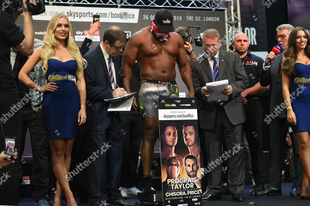 Dereck Chisora on the scales during a Weigh-In at East Wintergarden on 25th October 2019