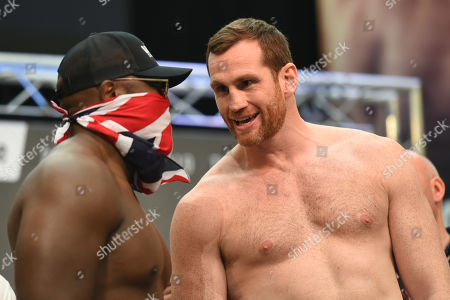 David Price (R) and Dereck Chisora during a Weigh-In at East Wintergarden on 25th October 2019