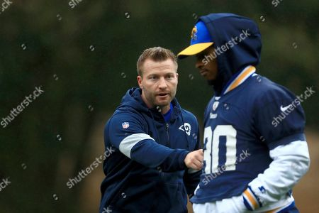 LA Rams Head Coach Sean McVay consults with Todd Gurley during the NFL training session at the Grove Hotel in Chandler's Cross, Watford, England, . The LA Rams are preparing for an NFL regular season game against the Cincinnati Bengals in London on upcoming Sunday