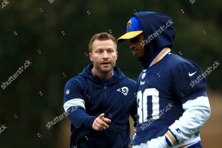 LA Rams Head Coach Sean McVay consults with Todd Gurley during the NFL training session at the Grove Hotel in Chandler's Cross, Watford, England, . The LA Rams are preparing for an NFL regular season game against the Cincinnati Bengals in London on Sunday