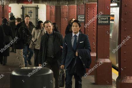Shane Johnson as Cooper Saxe and Sung Kang as John Mak