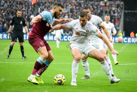 Jack O'Connell of Sheffield United holds off Robert Snodgrass of West Ham United