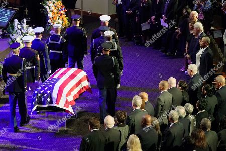 An honor guard stands next to the flag-draped casket of Rep. Elijah Cummings, D-Md., at the start of his funeral services at the New Psalmist Baptist Church in Baltimore, Md., on . At right are former President Barack Obama, Maya Rockeymoore Cummings, former President Bill Clinton, former first lady Hillary Clinton, House Speaker Nancy Pelosi, D-Calif., and former Vice President Joe Biden