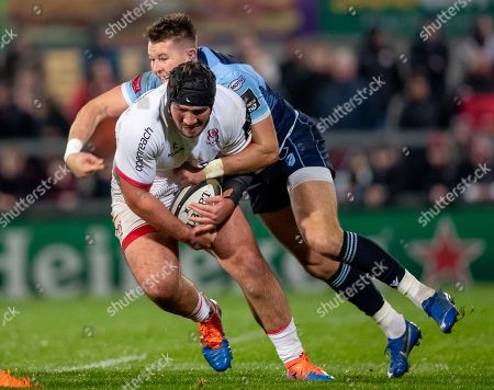 Ulster vs Cardiff Blues. Ulster's Tom O'Toole with Jason Harries of Cardiff Blues