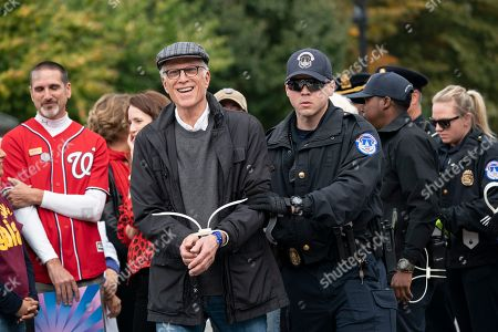 Actor Ted Danson is arrested at the Capitol for blocking the street after he, Jane Fonda, and other demonstrators called on Congress for action to address climate change, in Washington