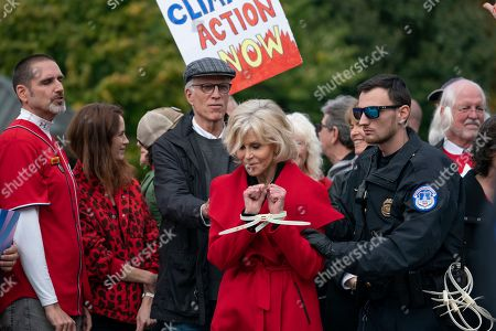 Jane Fonda, Ted Danson, Michael Marceau. Actress and activist Jane Fonda is arrested at the Capitol for blocking the street after she and other demonstrators called on Congress for action to address climate change, in Washington