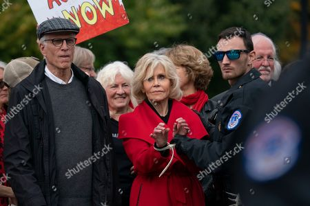 Jane Fonda, Ted Danson. Actress and activist Jane Fonda, joined at left by actor Ted Danson, is arrested at the Capitol for blocking the street after she and other demonstrators called on Congress for action to address climate change, in Washington