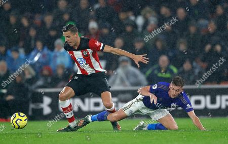 Southampton's Jan Bednarek, left, holds off Leicester's Harvey Barnes during the English Premier League soccer match between Southampton and Leicester City at St Mary's stadium in Southampton, England Friday, Oct., 25, 2019