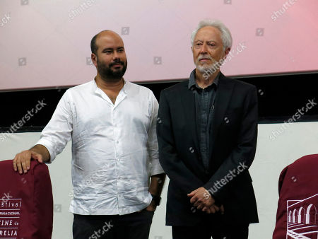"J.M. Coetzee, Ciro Guerra. Colombian director Ciro Guerra, left, presents the closing film ""Waiting for the Barbarians,"" accompanied by South-African author J.M. Coetzee, at the Morelia Film Festival, in Morelia, Mexico"