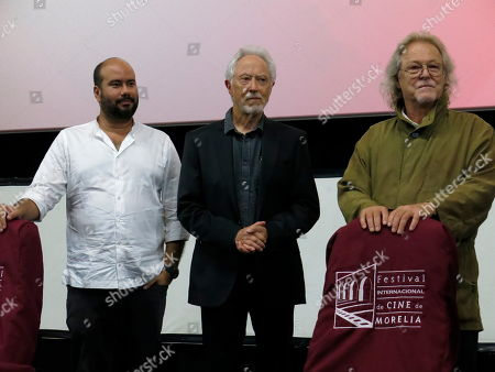 "Stock Image of Ciro Guerra, J.M. Coetzee, Michael Fitzgerald. Colombian director Ciro Guerra, from left, South African author J.M. Coetzee and American producer Michael Fitzgerald, present the closing film ""Waiting for the Barbarians,"" at the Morelia Film Festival, in Morelia, Mexico"