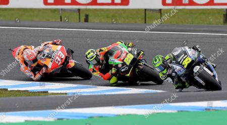 Stock Picture of From left, MotoGP Honda rider Marc Marquez of Spain, Aprilla rider Andrea Iannone from Italy and Honda rider Cal Cruchlow of Britain enter a turn during the Motorcycle Grand Prix at Phillip Island near Melbourne, Australia