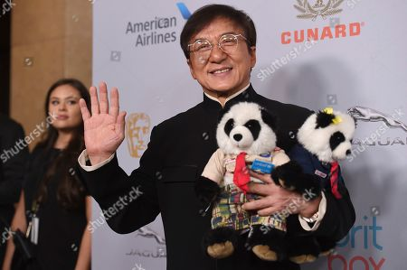 Jackie Chan arrives at the BAFTA Los Angeles Britannia Awards at the Beverly Hilton Hotel, in Beverly Hills, Calif