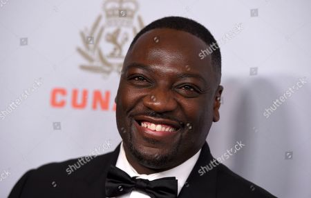 Stock Image of Adewale Akinnuoye-Agbaje arrives at the BAFTA Los Angeles Britannia Awards at the Beverly Hilton Hotel, in Beverly Hills, Calif