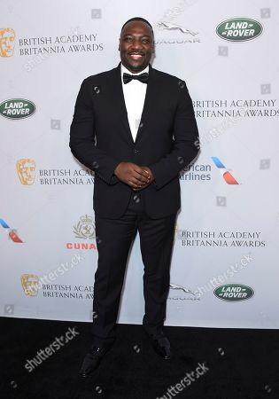 Stock Picture of Adewale Akinnuoye-Agbaje arrives at the BAFTA Los Angeles Britannia Awards at the Beverly Hilton Hotel, in Beverly Hills, Calif