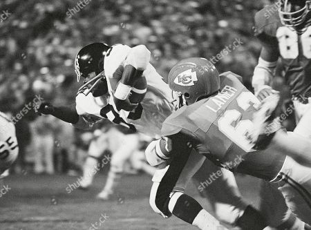 "Pittsburgh Steelers' John Fuqua (33) is brought down Kansas City Chiefs' Willie Lanier after a 3-yard game during an NFL football game in Kansas City, Mo. Lanier was one of the first black middle linebackers in pro football, breaking a barrier that kept minorities from playing the position regarded as the ""quarterback of the defense."" Lanier was a key part of the Kansas City defense that dominated the AFL and won a Super Bowl following the 1969 season"