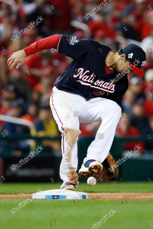 Stock Image of Washington Nationals third baseman Anthony Rendon can't get a glove on a single by Houston Astros' Robinson Chirinos during the seventh inning of Game 4 of the baseball World Series, in Washington