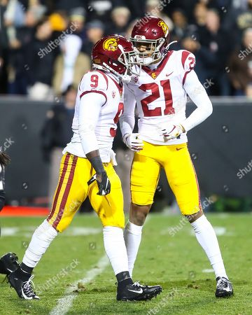 USC Trojans safety Isaiah Pola-Mao (21)) and USC Trojans cornerback Greg Johnson (9) celebrate Johnsonâ??s break up of a pass intended for Coloradoâ??s Laviska Shenault in the first half of the game between Colorado and USC at Folsom Field in Boulder, CO. USC rallied to win 35-31