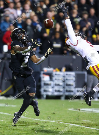 Colorado Buffaloes wide receiver Laviska Shenault Jr. (2) tries to make a catch over the outstretched arms of USC Trojans cornerback Greg Johnson (9) in the first half of the game between Colorado and USC at Folsom Field in Boulder, CO. Johnson just tipped the ball and Shenault couldnâ??t come up with it as USC rallied to win 35-31