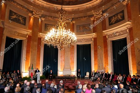 Stock Picture of Prime Minister Antonio Costa, at the lectern, delivers his speech at the end of a ceremony to swear in Portugal's new government at Lisbon's Ajuda Palace . Portugal's center-left Socialist Party has been sworn in for a second consecutive four-year term in government. Antonio Costa remains as prime minister, while Mario Centeno continues as finance minister and Augusto Santos Silva as foreign minister