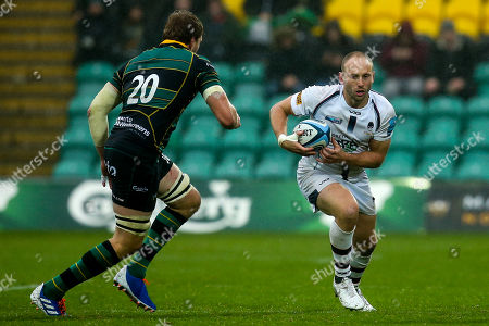 Chris Pennell of Worcester Warriors takes on Jamie Gibson of Northampton Saints