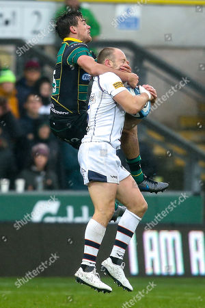 George Furbank of Northampton Saints challenges Chris Pennell of Worcester Warriors