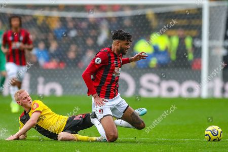 Watford midfielder Will Hughes (19) slides in to tackle AFC Bournemouth midfielder Philip Billing (29) during the Premier League match between Watford and Bournemouth at Vicarage Road, Watford