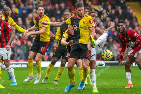 Stock Image of AFC Bournemouth forward Callum Wilson (13) tries to get around Watford defender Daryl Janmaat (2) during the Premier League match between Watford and Bournemouth at Vicarage Road, Watford