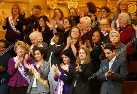 Jennifer Boysko, Janet Howell, Barbara Favola. State Senators Janet Howell, D-Fairfax, front left, Jennifer Boysko, D-Fairfax, second from left, and Sen. Barbara Favola, D-Arlington third from left, applaud a speech along with other ERA supporters in the gallery of the the House of Delegates at the Capitol in Richmond, Va., Democrats hoping to seize control of the Virginia Legislature in the 2019 elections say passing the long-stalled Equal Rights Amendment will be a top priority next year