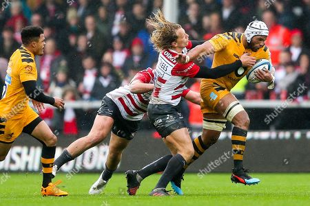 Nizaam Carr of Wasps is challenged by Billy Twelvetrees of Gloucester Rugby