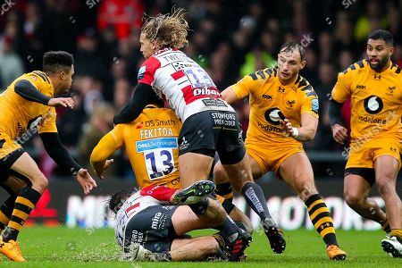 Stock Picture of Malakai Fekitoa of Wasps is tackled by Mark Atkinson and Billy Twelvetrees of Gloucester Rugby