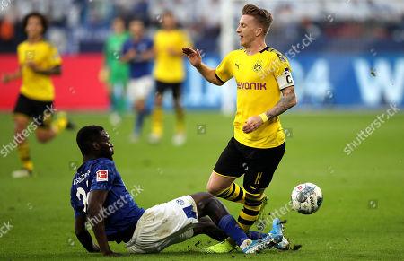 Schalke's Salif Sane (L) in action with Dortmund's Marco Reus during the German Bundesliga soccer match between FC Schalke 04 and Borussia Dortmund in Gelsenkirchen, Germany, 26 October 2019.