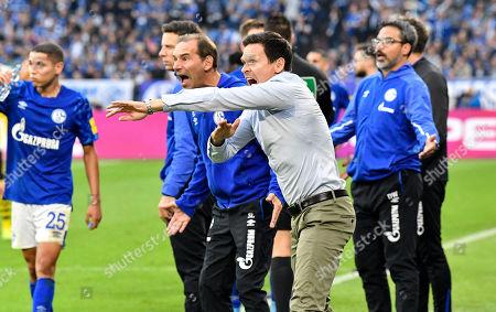 Stock Photo of Schalke co-ordinater Sascha Riether demands a penalty for hand play during the German Bundesliga derby soccer match between FC Schalke 04 and Borussia Dortmund in Gelsenkirchen, Germany