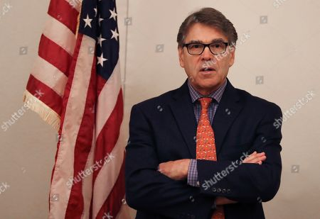 The outgoing U.S. Energy Secretary Rick Perry talks to the journalists during a roundtable presser in Dubai, United Arab Emirates