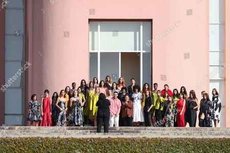Models gather for a group photo with Portuguese designers Marta Marques (C-R, striped blouse) and Paulo Almeida (C-L, pink sweater) after their outdoor show of the Marques'Almeida label during the Portugal Fashion show in Porto, Portugal, 26 October 2019. Spring/Summer 2020 collections are presented at the 45th Portugal Fashion until 26 October 2019.