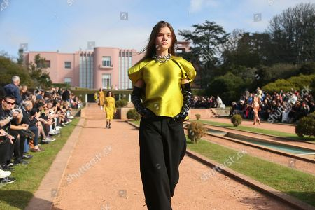 Stock Photo of A model presents a creation by Portuguese designers Marta Marques and Paulo Almeida for their Marques'Almeida label during the Portugal Fashion show in Porto, Portugal, 26 October 2019. Spring/Summer 2020 collections are presented at the 45th Portugal Fashion until 26 October 2019.