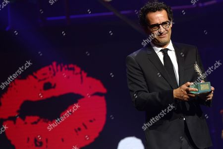Enrique Gonzalez Kuhn receives the Golden Spike award for the movie 'Ondog' by Chinese filmmaker Wang Quan'an during the closing ceremony of the 64th SEMINCI International Film Festival, in Valladolid, northern Spain, 26 October 2019.