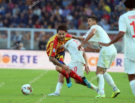 Lecce's Andrea Tabanelli (L) and Juve's Sami Khedira (R) in action during the Italian Serie A soccer match US Lecce vs FC Juventus at the Via del Mare stadium in Lecce, Italy, 26 October 2019.